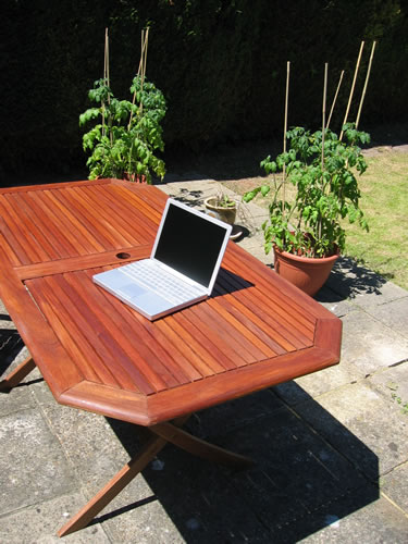 A picture of my Apple PowerBook on my garden table