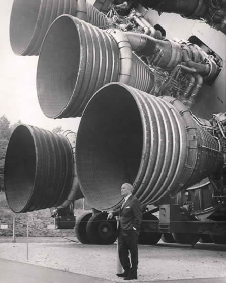 A picture of Werner von Braun stood next to a horizontal Saturn V rocket